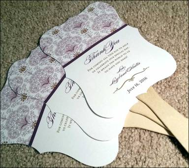 Beautiful fans to match the wedding invitations.